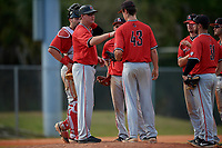 Ball State Cardinals head coach Rich Maloney (2) hands the ball to pitcher Landon McGill (43) during a pitching change during a game against the Mount St. Mary's Mountaineers on March 9, 2019 at North Charlotte Regional Park in Port Charlotte, Florida.  Ball State defeated Mount St. Mary's 12-9.  (Mike Janes/Four Seam Images)