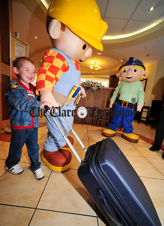 Bob the Builder helps Brian Flaherty from Nenagh with his luggage during his visit to the West County Hotel on Wednesday. Photograph by Declan Monaghan