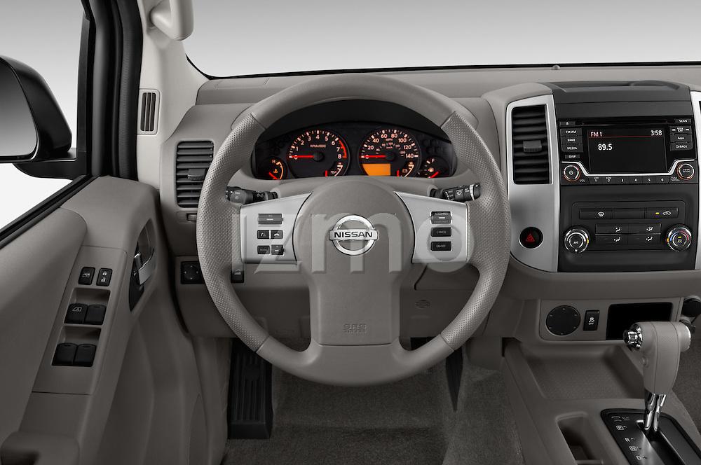 Car pictures of steering wheel view of a 2016 Nissan Frontier SV 4 Door Pick-up Steering Wheel