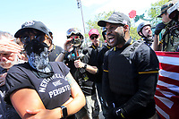 PORTLAND, OR - AUGUST 04: An argument ensues between someone on the alt-left (left) and a member of far-rights group (right) during a rally for gun rights' laws and free speech at Tom McCall Waterfront Park on August 4, 2018 in Portland, Oregon. (Photo by Karen Ducey/Getty Images)
