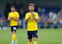 4th September 2021; Merton, London, England;  EFL Championship football, AFC Wimbledon versus Oxford City: A disappointed Matty Taylor of Oxford United applauds the Oxford United fans after full time