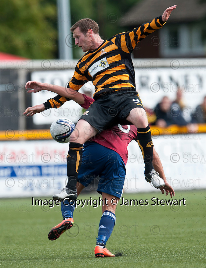 Alloa's Andy Kirk goes over the top of Livy's Kyle Wilkie.