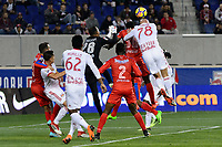 Harrison, NJ - Thursday March 01, 2018: Donis Escober, Johnny Palacios. Aurélien Collin. The New York Red Bulls defeated C.D. Olimpia 2-0 (3-1 on aggregate) during a 2018 CONCACAF Champions League Round of 16 match at Red Bull Arena.