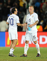 Jay DeMerit of USA is consoled by team-mate Landon Donovan at full-time. Brazil defeated USA 3-2 in the FIFA Confederations Cup Final at Ellis Park Stadium in Johannesburg, South Africa on June 28, 2009.