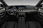 Stock photo of straight dashboard view of 2017 Mercedes Benz E Class AMG 43 4 Door Sedan
