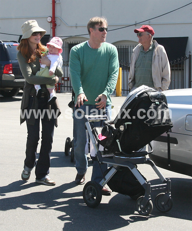 **ALL ROUND PICTURES FROM SOLARPIX.COM**.**SYNDICATION RIGHTS FOR UK ONLY**.Marcia Cross, the Desperate Housewives actress, enjoyed a Sunday afternoon with her familly in Brentwood, California, USA. She is seen changing nappies on the back of her hybrid SUV car. 23rd September 2007..This pic: Marcia Cross..JOB REF: 4811 RYS        DATE: 23_09_2007.**MUST CREDIT SOLARPIX.COM OR DOUBLE FEE WILL BE CHARGED* *UNDER NO CIRCUMSTANCES IS THIS IMAGE TO BE REPRODUCED FOR ANY ONLINE EDITION WITHOUT PRIOR PERMISSION*