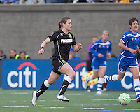Western New York Flash midfielder Brittany Bock (21) on the attack. In a Women's Professional Soccer (WPS) match, the Western New York Flash defeated the Boston Breakers, 2-1, at Harvard Stadium on April 17, 2011.