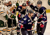 20 January 2017: Members of the University of Connecticut Huskies celebrate a third period goal against the University of Vermont Catamounts at Gutterson Fieldhouse in Burlington, Vermont. The Huskies fell to the Catamounts 5-4 in the first game of their Home-and-Home Hockey East Series. Mandatory Credit: Ed Wolfstein Photo *** RAW (NEF) Image File Available ***