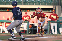 Garret Stubbs #51 of the Southern California Trojans gets Taylor Sparks #25 of the UC Irvine Anteaters in a rundown during a game at Dedeaux Field on April 29, 2014 in Los Angeles, California. Stanford defeated Southern California, 6-2. (Larry Goren/Four Seam Images)