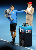 Novak Djokovic (SRB) points to his team bench as he celebrates with the year end ATP World Tour No.1 ranked player trophy during Day One of the Barclays ATP World Tour Finals 2015 played at The O2, London on November 15th 2015