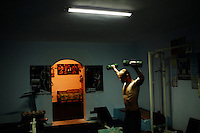 Andrei lifts weights inside a gym in Tiraspol, Transnistria on 17 April 2009.