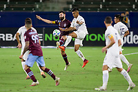CARSON, CA - SEPTEMBER 19: Jack Price #19 of the Colorado Rapids and Efrain Alvarez #26 battle for a ball during a game between Colorado Rapids and Los Angeles Galaxy at Dignity Heath Sports Park on September 19, 2020 in Carson, California.
