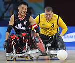 Ian Chan (6) of Surrey, B.C. charges after the ball with Ryley Batt of Australia in Canada's 41 - 40 loss to Australia in wheelchair rugby semi-final action in Beijing during the Paralympic Games, Monday, Sept., 15, 2008.   Photo by Mike Ridewood/CPC