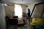 Eberilda Verdugo, 66, of San Jose El Recreo, San Marcos, cleans up the house destroyed by a 7.4 earthquake struck Guatemala Wednesday Nov. 7.
