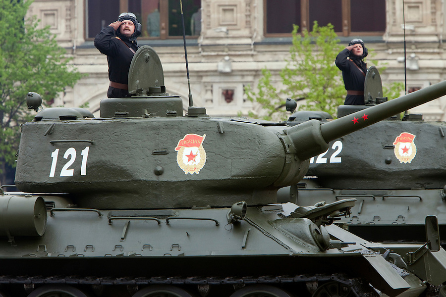 Moscow, Russia, 06/05/2010..Commanders on Soviet World War Two era T-34 tanks salute during a Red Square rehearsal for the forthcoming May 9 Victory Day parade, scheduled to be the largest for many years.