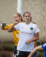In a National Women's Soccer League Elite (NWSL) match, Portland Thorns FC defeated the Boston Breakers, 2-1, at Dilboy Stadium on July 21, 2013.  Portland Thorns FC forward Alex Morgan (13) signals for the ball in front of Boston Breakers goalkeeper Ashley Phillips (24) during a corner kick.