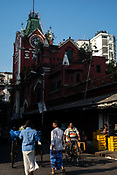Pedestrians outside the century-old Sir Stuart Hogg Market, also known as the New Market in Kolkata, West Bengal  on Friday, May 26, 2017. Photographer: Sanjit Das