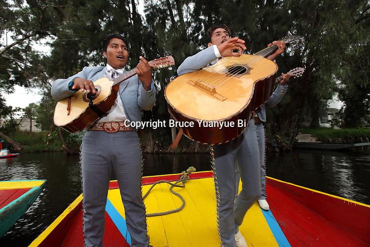 A mariachi band performing on a Trajinera raft. Xochimilco. Mexico City. Mexico