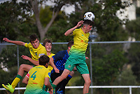 George Ott (left) clears during the Central League football match between Miramar Rangers and Lower Hutt AFC at David Farrington Park in Wellington, New Zealand on Saturday, 10 April 2021. Photo: Dave Lintott / lintottphoto.co.nz