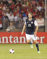 USMNT defender Clarence Goodson (21) brings the ball forward.  In CONCACAF Gold Cup Group Stage, the U.S. Men's National Team (USMNT) (blue/white) defeated Costa Rica (red/blue), 1-0, at Rentschler Field, East Hartford, CT on July 16, 2013.