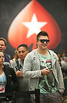 Team Pokerstars Pro Maxim Lykov hits the rails after being eliminated.