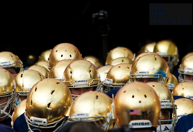 Sept. 21, 2013; The football team gathers in the tunnel.<br /> <br /> Photo by Matt Cashore