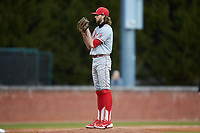 St. John's Red Storm starting pitcher Nick Mondak (14) looks to his catcher for the sign against the Western Carolina Catamounts at Childress Field on March 12, 2021 in Cullowhee, North Carolina. (Brian Westerholt/Four Seam Images)