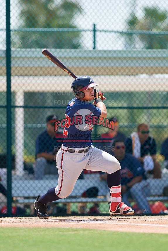 GCL Braves left fielder Jefrey Ramos (22) hits an RBI single during a game against the GCL Pirates on July 26, 2017 at Pirate City in Bradenton, Florida.  GCL Braves defeated the GCL Pirates 12-5.  (Mike Janes/Four Seam Images)