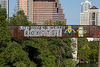 """Austin is home to famous inspiring and colorful pop-art graffiti paintings such as the """"Let's Pretend we are ROBOTS!"""" on the Austin Railroad Graffiti Bridge over Lady Bird Lake in downtown Austin, Texas."""