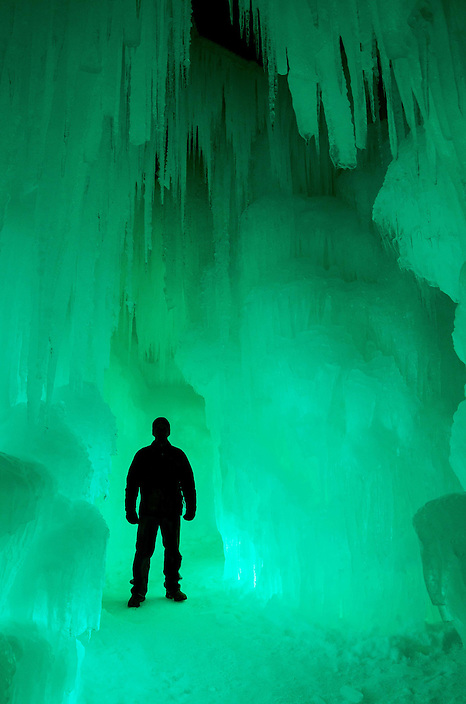 Towering pillars of ice form passages and corridors bathed in ever changing colored lights inside the Ice Castle at Loon Mountain.