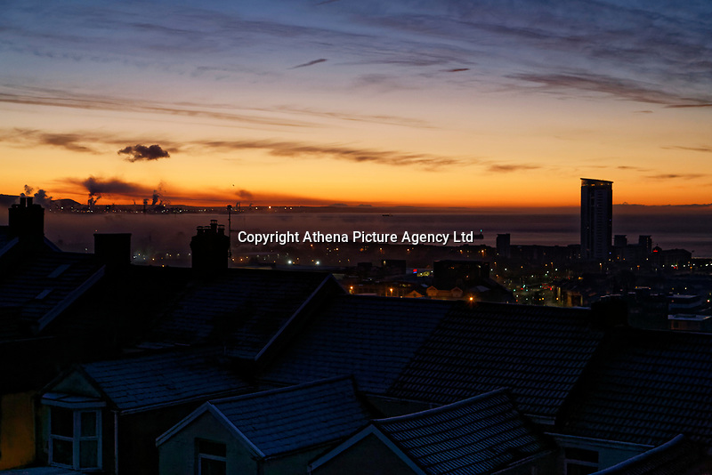 Clear skies over roof tops during an early frosty morning in Swansea, Wales, UK. Tuesday 12 December 2017