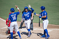 Kansas City Royals second baseman Gabriel Cancel (14) is congratulated by Anderson Miller (16) and Nick Pratto (13) after hitting a home run during an Instructional League game against the Cincinnati Reds on October 2, 2017 at Surprise Stadium in Surprise, Arizona. (Zachary Lucy/Four Seam Images)