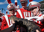 "Three members of the Wisconsin Band react to having an alligator thrown in their face by an employee of Gatorland, the ""gator capital of the world,"" while waiting for their turn to march in the Citrus Parade."