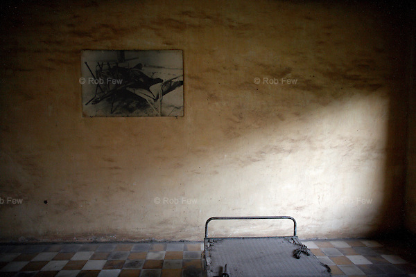 Only seven prisoners are believed to have survived their time in S-21. Their accounts reveal a regimen of daily horror. Interrogations took place from 7am until midnight and included the use of electric shocks, waterboarding, whipping and cutting. This is one of several beds that prisoners were tied to while being tortured.<br /> <br /> On 17th April 1975, after five years of civil war, Cambodia's capital Phnom Penh fell to the Khmer Rouge, who instigated a brutal reign of terror that would see the death of some 1.7 million Cambodians. In an attempt to create a self-sufficient agrarian paradise, cities were emptied, money and religion were banned and roughly a quarter of the population was worked and starved to death or executed. <br /> <br /> At the centre of this brutality was S-21, also known as Tuol Sleng, the Khmer Rouge prison located in the grounds of an old Phnom Penh school. Before the Vietnamese liberation of Phnom Penh on 7th January 1979, at least 14,000 people were tortured and executed here or at the nearby Choeung Ek killing field.