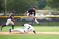 GCL Yankees West second baseman Jose Carrera (2) tries to tag a runner between his legs after jumping to receive the throw during the second game of a doubleheader against the GCL Yankees West on July 19, 2017 at the Yankees Minor League Complex in Tampa, Florida.  GCL Yankees West defeated the GCL Yankees East 3-1.  (Mike Janes/Four Seam Images)