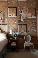 Detail of the hand-painted chinoiserie wallpaper in one of the bedrooms, its decorative panels divided up by painted fretwork borders
