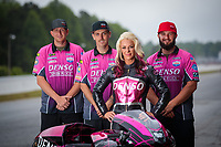 May 3, 2019; Commerce, GA, USA; NHRA pro stock motorcycle rider Angie Smith poses for a portrait with crew members prior to qualifying for the Southern Nationals at Atlanta Dragway. Mandatory Credit: Mark J. Rebilas-USA TODAY Sports