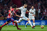 Karim Benzema (r) of Real Madrid competes for the ball with Stefan Savic of Atletico de Madrid  during the La Liga 2017-18 match between Atletico de Madrid and Real Madrid at Wanda Metropolitano  on November 18 2017 in Madrid, Spain. Photo by Diego Gonzalez / Power Sport Images