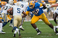 Pitt defensive lineman Shakir Soto (52) makes a tackle. The Pitt Panthers defeated the Georgia Tech Yellow Jackets 37-34 at Heinz Field in Pittsburgh, Pennsylvania on October 08, 2016.