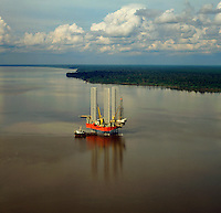 Jack-up oil exploration rig working in shallow estuary off the coast of Sumatra in the Malacca Straits.  Indonesia.