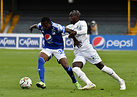BOGOTA - COLOMBIA, 18-04-2021: Jorge Rengifo de Millonarios F. C. y Juan Jose Tello de Deportivo Cali disputan el balon durante partido entre Millonarios F. C. y Deportivo Cali de la fecha 19 por la Liga BetPlay DIMAYOR I 2021 jugado en el estadio Nemesio Camacho El Campin de la ciudad de Bogota. / Jorge Rengifo of Millonarios F. C. and Juan Jose Tello of Deportivo Cali figth for the ball during a match between Millonarios F. C. and Deportivo Cali of the 19th date for the BetPlay DIMAYOR I 2021 League played at the Nemesio Camacho El Campin Stadium in Bogota city. / Photo: VizzorImage / Luis Ramirez / Staff.