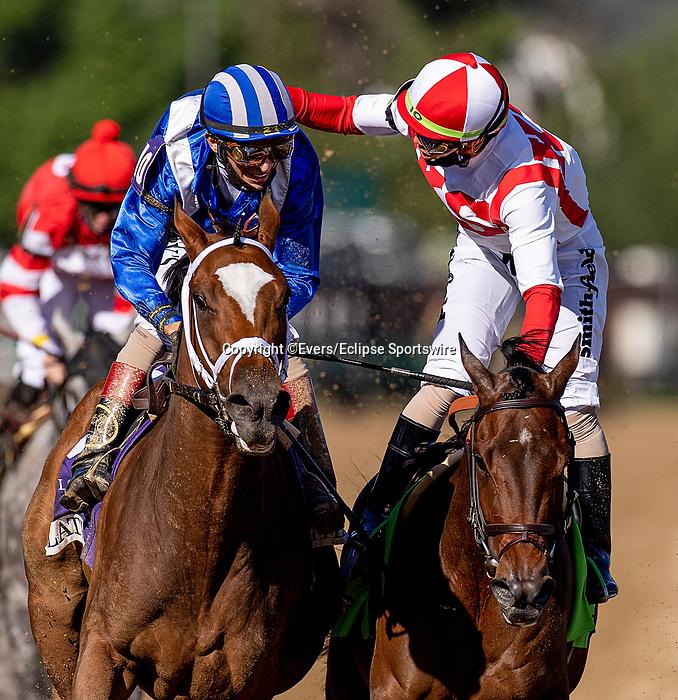 April 30, 2021: Irad Ortiz Jr. (red cap) congratulates winning jockey John Velazquez aboard Malathaat after winning the Kentucky Oaks at Churchill Downs in Louisville, Kentucky on April 30, 2021. EversEclipse Sportswire/CSM