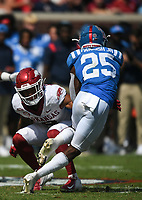 Arkansas defensive back Greg Brooks Jr. (9) blocks Ole Miss running back Henry Parrish Jr. (25), Saturday, October 9, 2021 during the third quarter of a football game at Vaught Hemingway Stadium in Oxford, Miss. Check out nwaonline.com/211010Daily/ for today's photo gallery. <br /> (NWA Democrat-Gazette/Charlie Kaijo)
