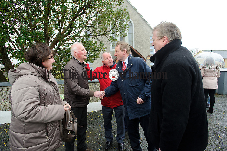 Enda Kenny, Taoiseach is introduced to local mass-goers John Gibson and Margaret Considine by Councillor Gabriel Keating and Pat Breen, TD during his visit to Loop Head to launch the Fine Gael tourism initiative. Photograph by John Kelly.