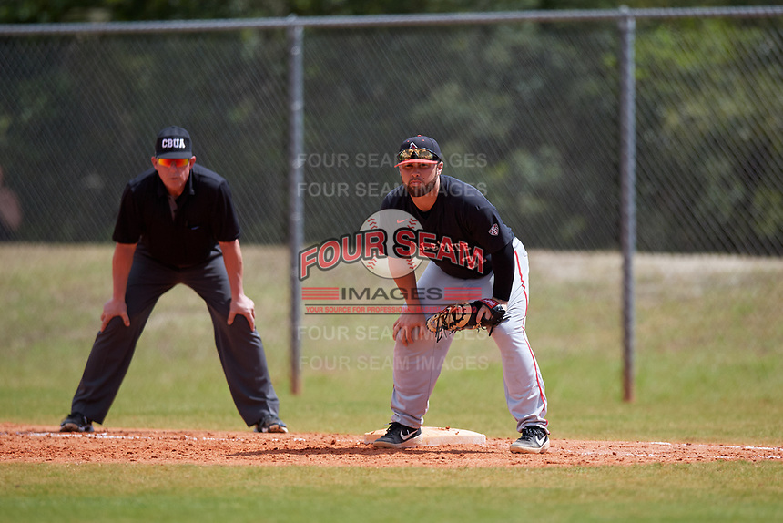 Ball State Cardinals first baseman John Ricotta (31) and first base umpire Phil Pupillo during a game against the Saint Joseph's Hawks on March 9, 2019 at North Charlotte Regional Park in Port Charlotte, Florida.  Ball State defeated Saint Joseph's 7-5.  (Mike Janes/Four Seam Images)