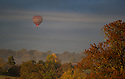 19/10/18<br /> <br /> A hot air balloon rises above misty fields surrounded by stunning autumn colour near Parwich in the the Derbyshire Peak District.<br /> <br /> <br /> All Rights Reserved, F Stop Press Ltd. (0)1335 344240 +44 (0)7765 242650  www.fstoppress.com rod@fstoppress.com