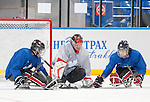 Sochi, RUSSIA - Mar 2 2014 -  Benoit St-Amand (goalie) is tested by his teammates during practice before the 2014 Paralympics in Sochi, Russia.  (Photo: Matthew Murnaghan/Canadian Paralympic Committee)