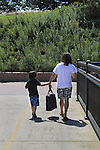 Mother with son walking to go swimming in Denver, Colorado. .  John offers private photo tours in Denver, Boulder and throughout Colorado. Year-round Colorado photo tours.