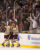 Steven Whitney (BC - 21), Bill Arnold (BC - 24), Michael Matheson (BC - 5) - The Boston College Eagles defeated the Northeastern University Huskies 6-3 for their fourth consecutive Beanpot championship on Monday, February 11, 2013, at TD Garden in Boston, Massachusetts.