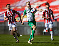 5th April 2021; Bet365 Stadium, Stoke, Staffordshire, England; English Football League Championship Football, Stoke City versus Millwall; Billy Mitchell of Millwall controls a loose ball as he breaks forward